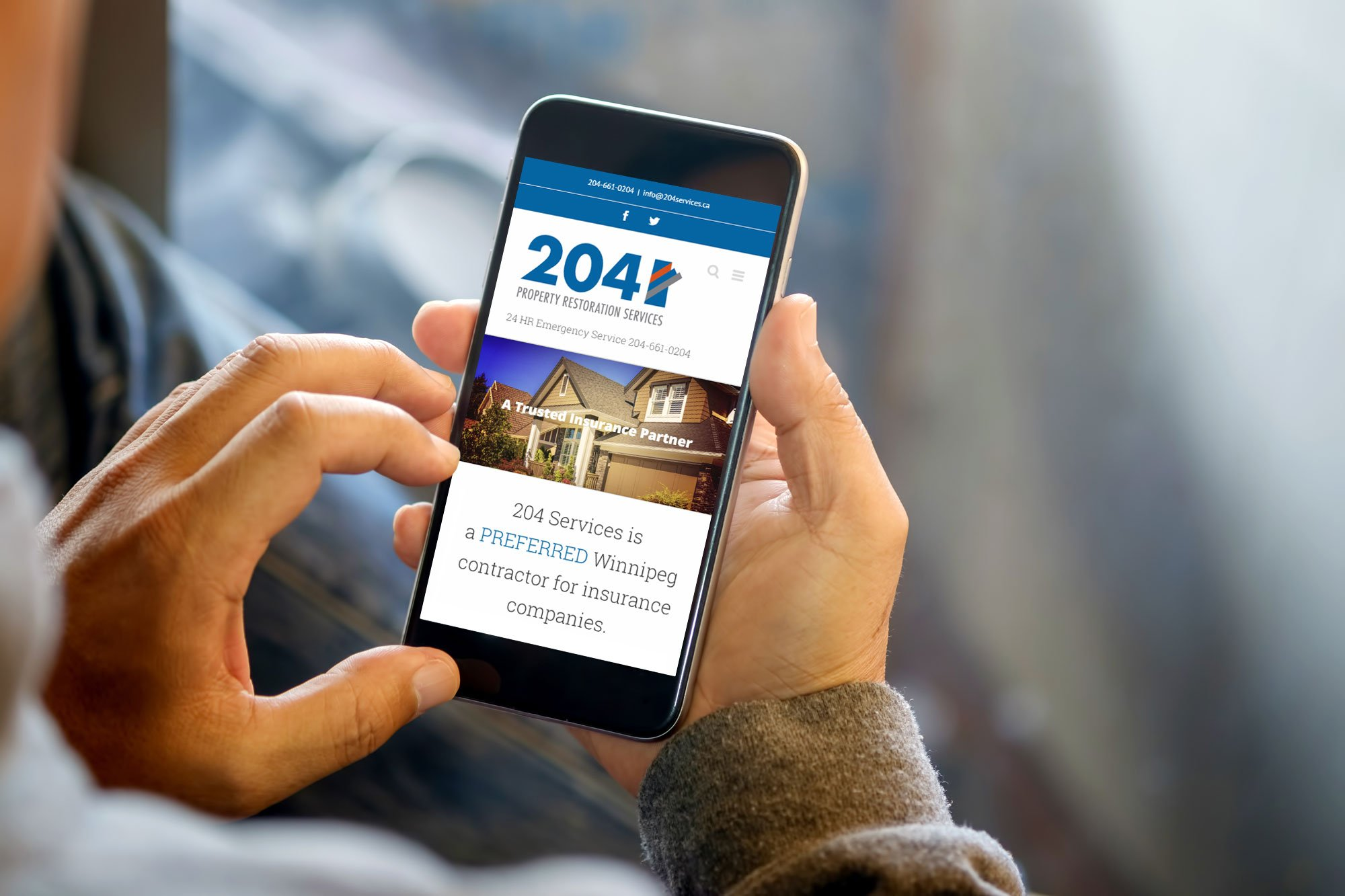 204 property restoration services homepage on a mobile device
